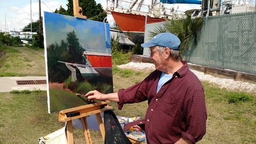 roger painting on Riberia Street - Copy